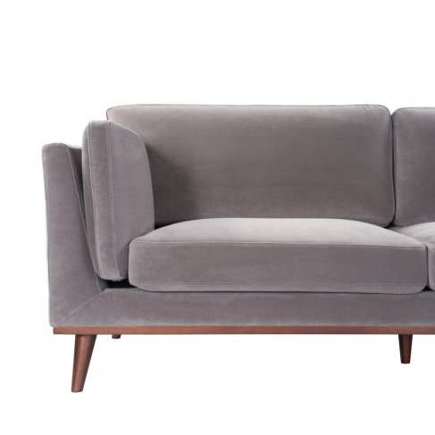 mink velvet stone gray velvet sofa 3 seater walnut legs front view partially obscured left